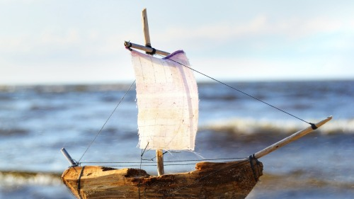 wooden sail ship toy model in the sea